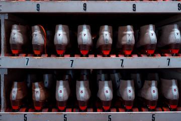 Roller skates sitting on shelves