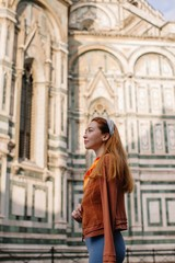 Attractive redhead woman enjoying the morning near the Duomo in Florence