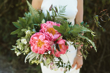 A gorgeous bridal bouquet with large pink peonies