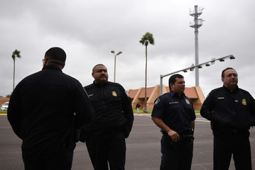 U.S. Customs and Border Protection officers stand during a tour of the Hidalgo International Bridge in Hidalgo
