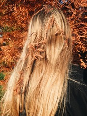 Cypress in hair of blond woman