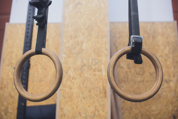 Traditional wooden gymnast rings hanging in the interior.