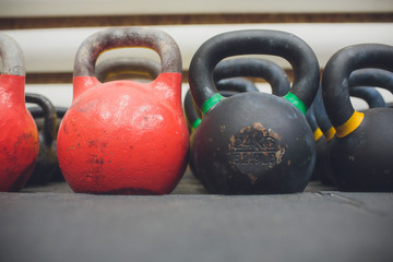 In a sports hall set of weights.