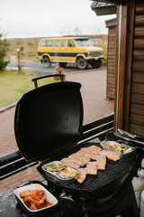 barbecue at a country house with salmon fish grilled steaks