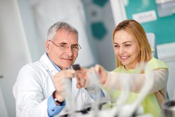 Patient and dentist studding teeth snapshot