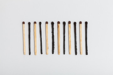 Matches forming sequence on slightly gray background