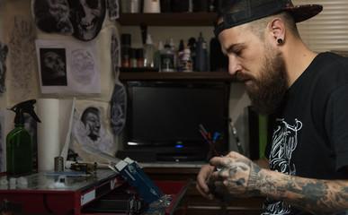 Master preparing for making tattoo