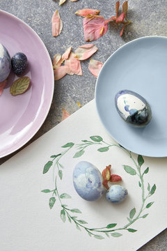 Easter composition of eggs on a plate and a painted circular fra