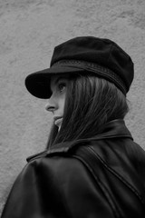 black and white portrait of stylish girl in the hat