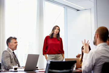 Businesswoman Listening To Colleagues In Office