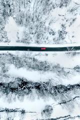 Aerial view of a road through a snowy field
