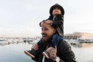 Laughing man carrying son