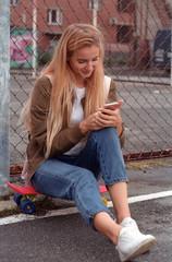 Teen girl using smartphone