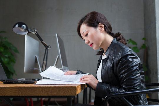Business woman using laptop indoor