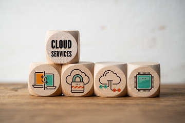 "cubes with icons smybolizing ""cloud services"" on wooden background"