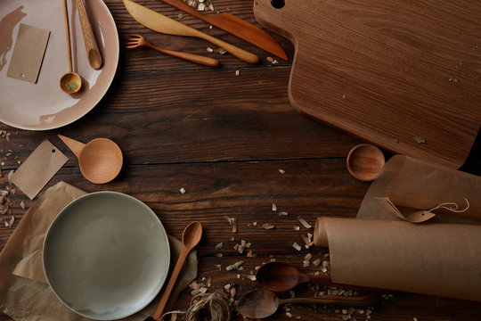 Overhead view of kitchen utensils on wooden table