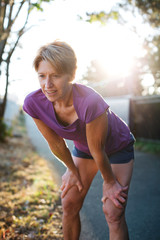 Healthy mature woman on urban morning run