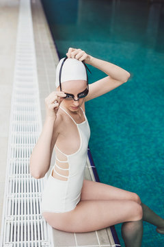 Woman Swimmer Putting Goggles