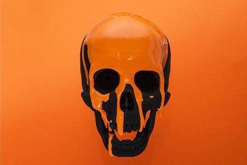 Black Skull with dripping orange paint