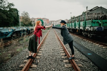 beautiful lesbian couple shoot on an abandoned railway