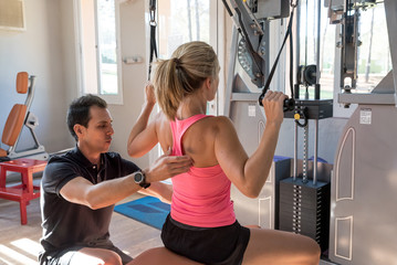 Woman training with instructor