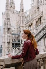 Young redhead girl on Milan Duomo roof