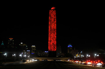 Drivers circle the National WWI Museum and Memorial to view the more than 5,000 poppies projected on the Liberty Memorial in Kansas City
