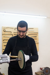 Man fixing trumps in his repair workshop