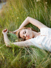 Pretty woman lying in grass
