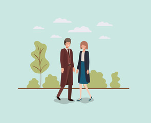 elegant business couple walking in the park