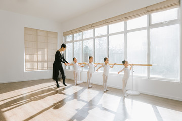 Ballet teaching teaching students in class