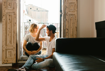 beautiful young couple spending time together at home