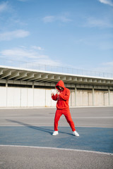 Anonymous boxer in red at street