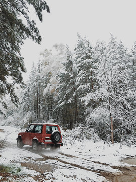 Jeep driving in snowy woods