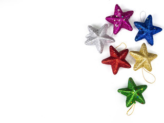 Top view of  star decorations on white  background. Christmas holiday concept