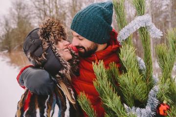 Kissing couple next to christmas tree