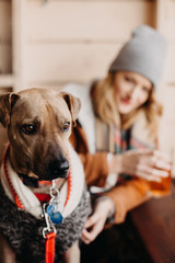 Woman Sitting at a Brewery with her Dog