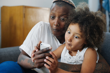 Mother and daughter using phone