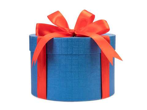Round blue gift box with red bow on a white background