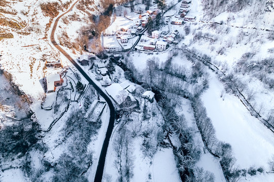 Aerial view of a small snowy village