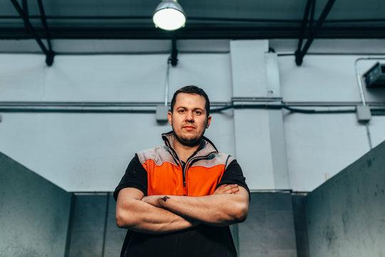 Repairman in the car workshop