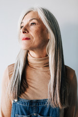 Portrait of a senior woman with grey long hair.