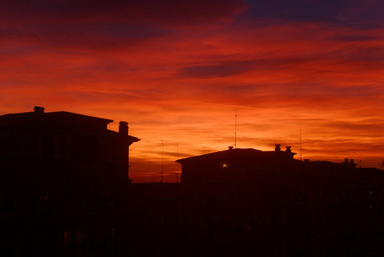 Red bloody sunset with rooftops