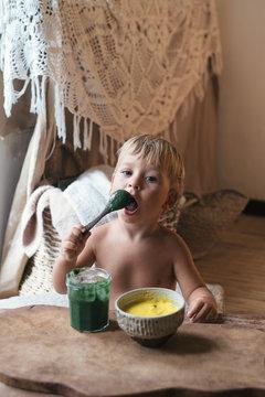Little Kid Having Healthy Raw Veggie Breakfast At Home