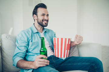 Positive cheerful handsome bearded man with snack and refreshmen