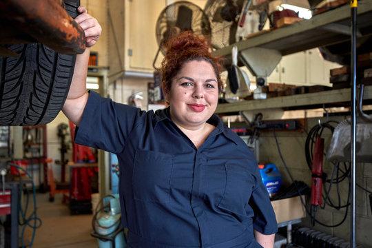 Portrait of Female Car Mechanic in Her Shop