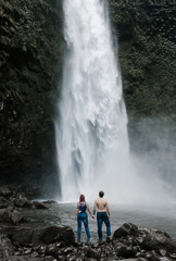 Couple standing near waterfall