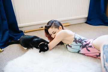 Attractive woman with cat at home