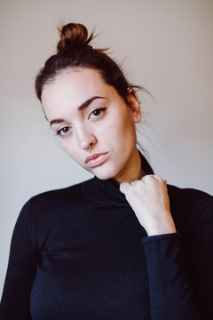 Portrait of woman with top knot