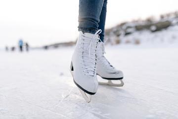 Crop woman skating on rink